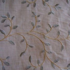"Embroidered green leaves on linen look polyester home dec fabric 1-1/2 yards x 56"" wide."